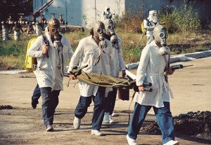team in gas masks with stretcher