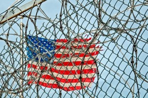Flag behind a prison fence