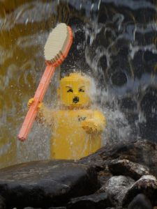 lego man in a shower